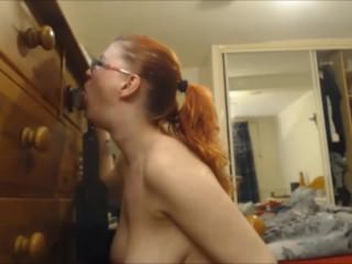 Busty MILF Shoving it Down Her Throat