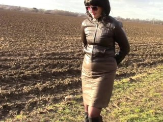 Pissing in a dark-skinned leather micro-skirt and cuffs