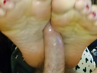 Footjob wife cumshot